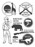 Safari in Africa. Giraffe, rhino, cheetah and hunter with weapon. Vintage style. It can be used as logo. Vector Stock Image