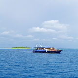 Safari Boat and Tropical Island, Maldives Royalty Free Stock Image