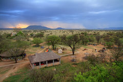 Safari Camp under Storm. A safari camp in the serengeti as a storm moves in stock image