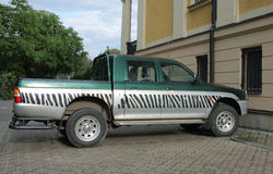 Safari car with black and white stripes Stock Image