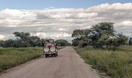 Safari car on the roads in Tanzania Royalty Free Stock Images