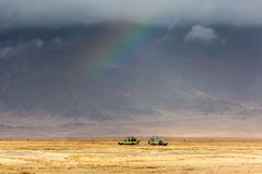 Safari cars inside Ngorongoro Crater stock photo