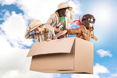 Safari. Children in a cardboard box playing Safari Stock Photography