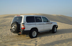 Safari in Desert. Safari powerful jeep standing in the middle of a desert dune royalty free stock images
