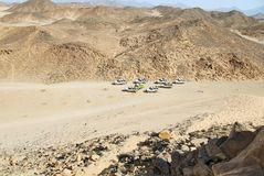 Safari at Egypt desert. Safari jeeps at Sahara dry desert by Hurghada, Egypt royalty free stock photo