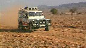 Safari in the foothills of the Atlas Mountains. Morocco. Outlander Jeep rides on a rocky desert in the foothills of the Atlas Mountains. Morocco.n stock video footage