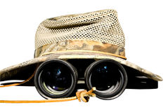 Safari Hat and Binoculars. A mesh and cloth safari hat with binoculars underneath. Search out the details or information you need to stay ahead in business royalty free stock images