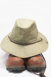 Safari Hat and Hiking Boots. A safari type hat and hiking boots royalty free stock photo