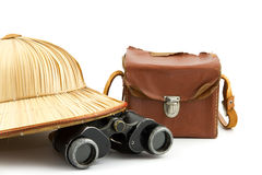 Safari hat, vintage camera bag and binoculars. Reed safari hat, vintage camera and binoculars isolated on white stock photography