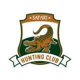 Safari hunting club badge with alligator croc. Safari Hunting club emblem. Vector  shield shape icon or badge with African crocodile alligator in river and Royalty Free Stock Images