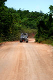 Safari jeep on dirt road Royalty Free Stock Photos