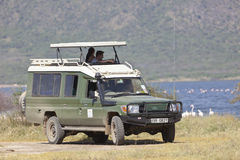 Safari Jeep With Tourists, editorial Imagenes de archivo