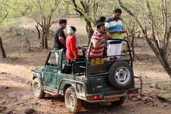 Safari jeep in zone 4 of Ranthambore park. RANTHAMBORE, INDIA-JUNE 24: People eagerly waiting for tiger sighting in Safari jeep during game drive in Ranthambore stock photo