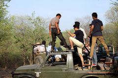 Safari jeep in zone 4 of Ranthambore park. RANTHAMBORE, INDIA-JUNE 24: People eagerly waiting for tiger sighting in Safari jeep during game drive in Ranthambore royalty free stock photos