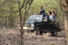 Safari jeep in zone 4 of Ranthambore park. RANTHAMBORE, INDIA-JUNE 24: People eagerly waiting for tiger sighting in Safari jeep during game drive in Ranthambore stock images