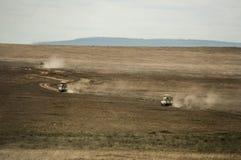 Safari jeeps crossing Serengeti, Tanzania Stock Images