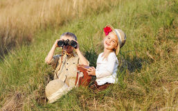 Safari kids. Cute children playing pretend safari game together outdoors. happy brother and sister stock photos