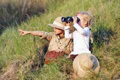 Safari kids. Cute children playing pretend safari game together outdoors. happy brother and sister Stock Images