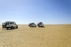 Safari Land cruisers. A group of land cruisers stopping for rest in a safari in the Egyptian western desert Stock Photos
