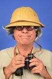 Safari Man. Man with binoculars and a safari pit nelment Stock Images