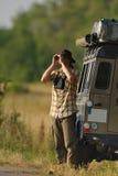 Safari. Man on safari with a Land Rover Defender Stock Image