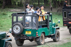 Safari. Off-road jeep with family visitors. Minneriya. Sri Lanka. Royalty Free Stock Image