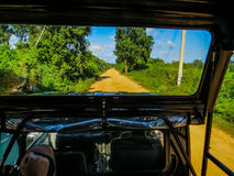 Safari. People in a four-wheel drive jeep doing safari in Yala National Park, Sri Lanka Royalty Free Stock Photo