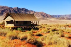 Safari Tent in the Namib Desert (Namibia). Luxury Safari Tent in the Namib Desert with the Naukluft Mountains in the Background (Namibia Royalty Free Stock Image