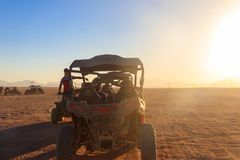 Safari trip through egyptian desert driving buggy cars. Safari trip through the egyptian desert driving buggy cars stock photography