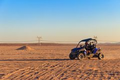 Safari trip through egyptian desert driving buggy cars. Safari trip through the egyptian desert driving buggy cars royalty free stock photography