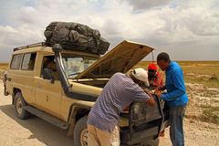 Safari Truck Breakdown. Fixing a broken down safari truck while on route stock photography