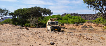 Safari Truck. A truck on a safari to the search for desert elephants Royalty Free Stock Photo