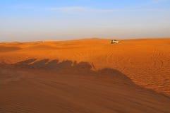 Safari in UAE. Shadows of jeeps on dune during desert safari in UAE, near Dubai stock photo