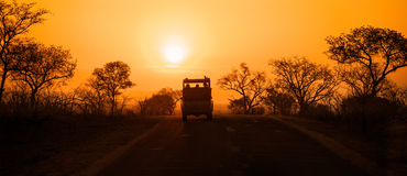 Safari vehicle at sunset Stock Image