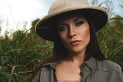 Safari woman in swamp Royalty Free Stock Photo