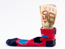 Safe banking. Home - banking: euros hidden in old sock Stock Image