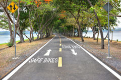Safe bikes words with white arrow sign marking on road surface Stock Photography
