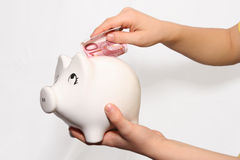 Safe box. Child save the money in pig safe box Royalty Free Stock Photos