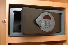 Safe box in closet. Close up of a safe box in closet royalty free stock photos