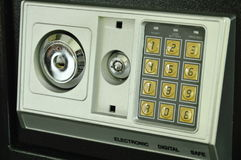 Safe box with keyhole and security electronic number for double safety system Royalty Free Stock Photography