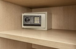 Safe box for storing valuables in a wooden cupboard. Inside Royalty Free Stock Photography