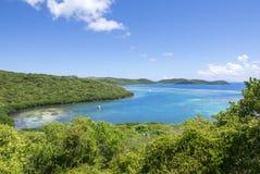 Safe Caribbean bay in Isla Culebra. Shallow calm Dakity Bay with clear blue water of Ensenada Honda in the Caribbean island of Isla Culebra in Puerto Rico Stock Image