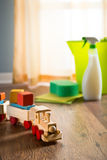 Safe cleaning products. Wooden toy train with cleaning products on background next to a window stock photo