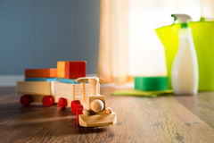 Safe cleaning products. Wooden toy train with cleaning products on background next to a window royalty free stock images