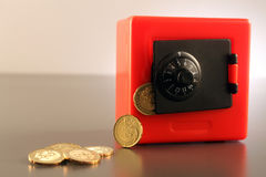 Safe with Coins Stock Photography