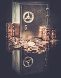 Safe with coins. Conceptual little safe with euro coins Royalty Free Stock Photography