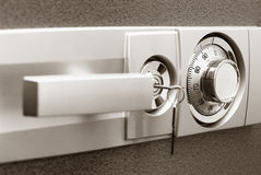 Safe with combination lock. Key and knob Royalty Free Stock Image