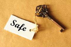 Safe concept. With key and label showing secure investment Royalty Free Stock Image