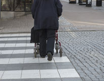 Safe crossing with rollator Royalty Free Stock Photography