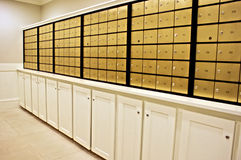 Safe deposit. Rows of safe deposit boxes and white cabinets Stock Image